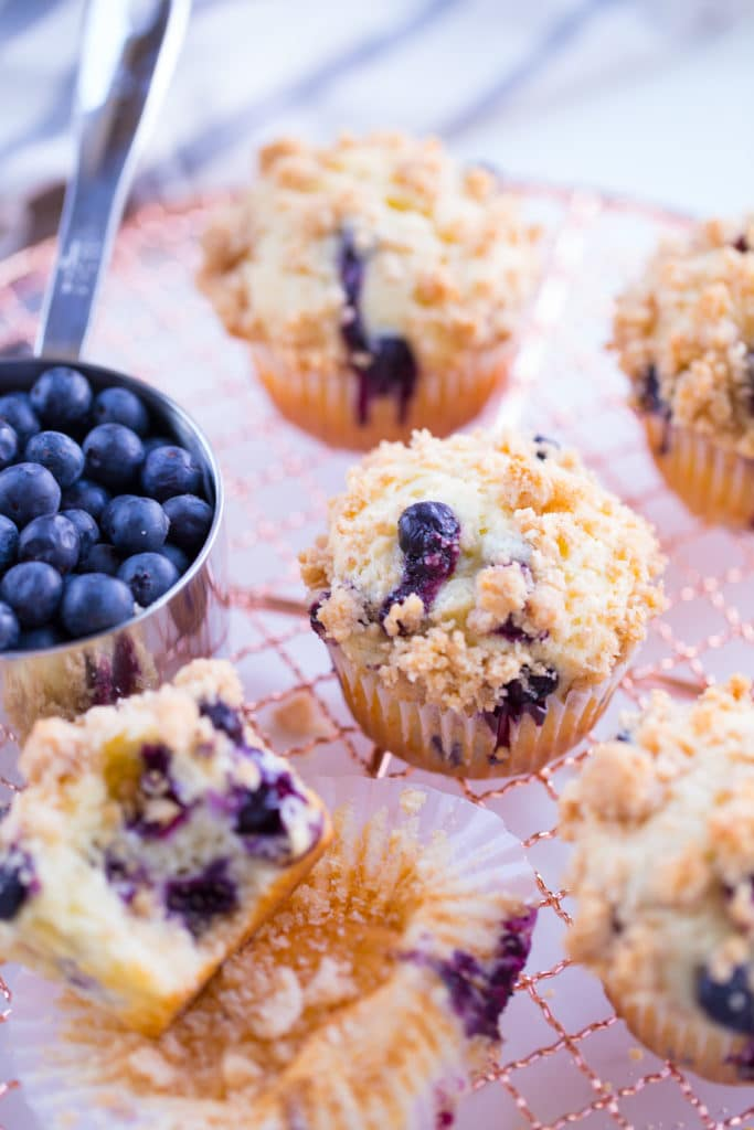 blueberry streusel muffins on rose gold wire rack