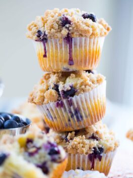 three blueberry muffins stacked on top of each other