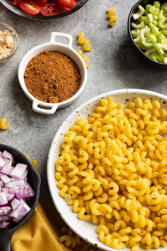 close up shot of jerk seasoning and pasta