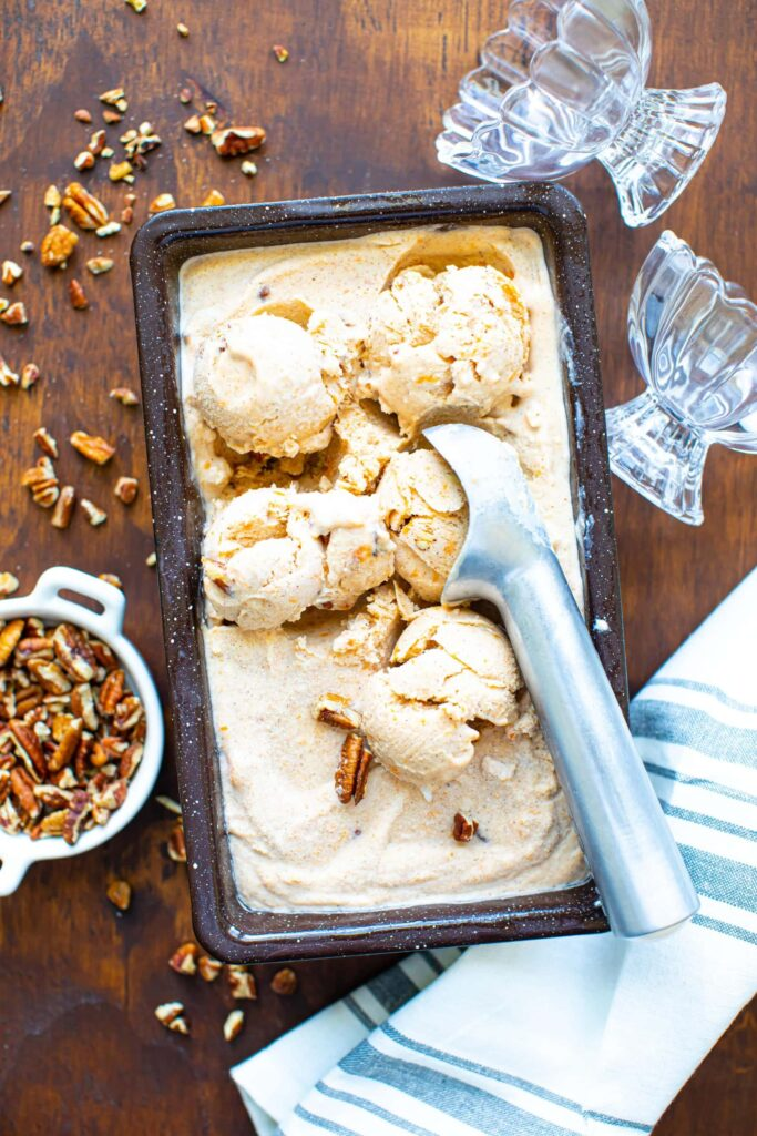 ice cream in brown speckled loaf pan on wooden surface
