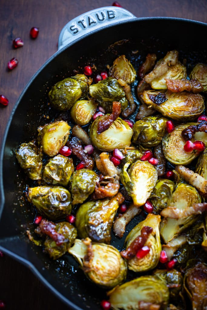 brussels sprouts in a silver skillet on a wooden table