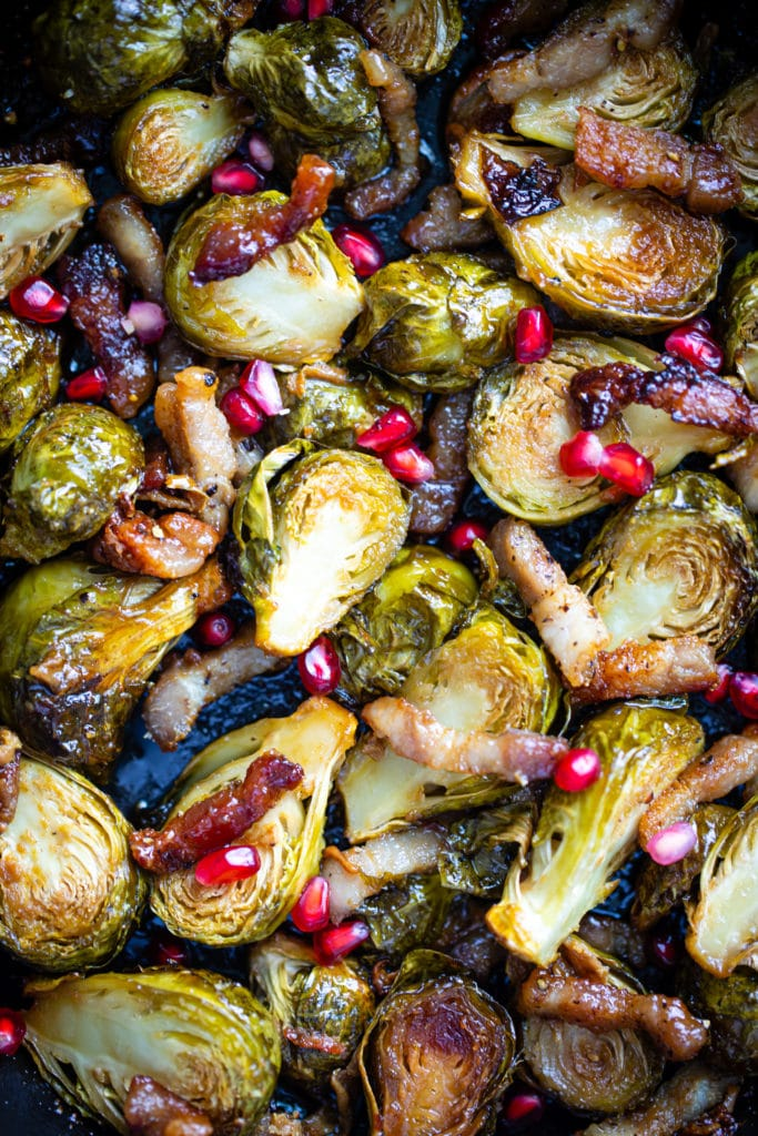 close up of Brussels sprouts in a pan with pork belly