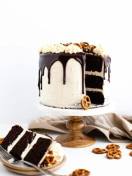 chocolate stout layer cake on a marble cake stand
