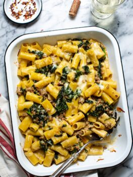 rigatoni with sausage and kale in white baking dish