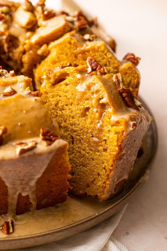 sliced sweet potato pound cake on large beige plate