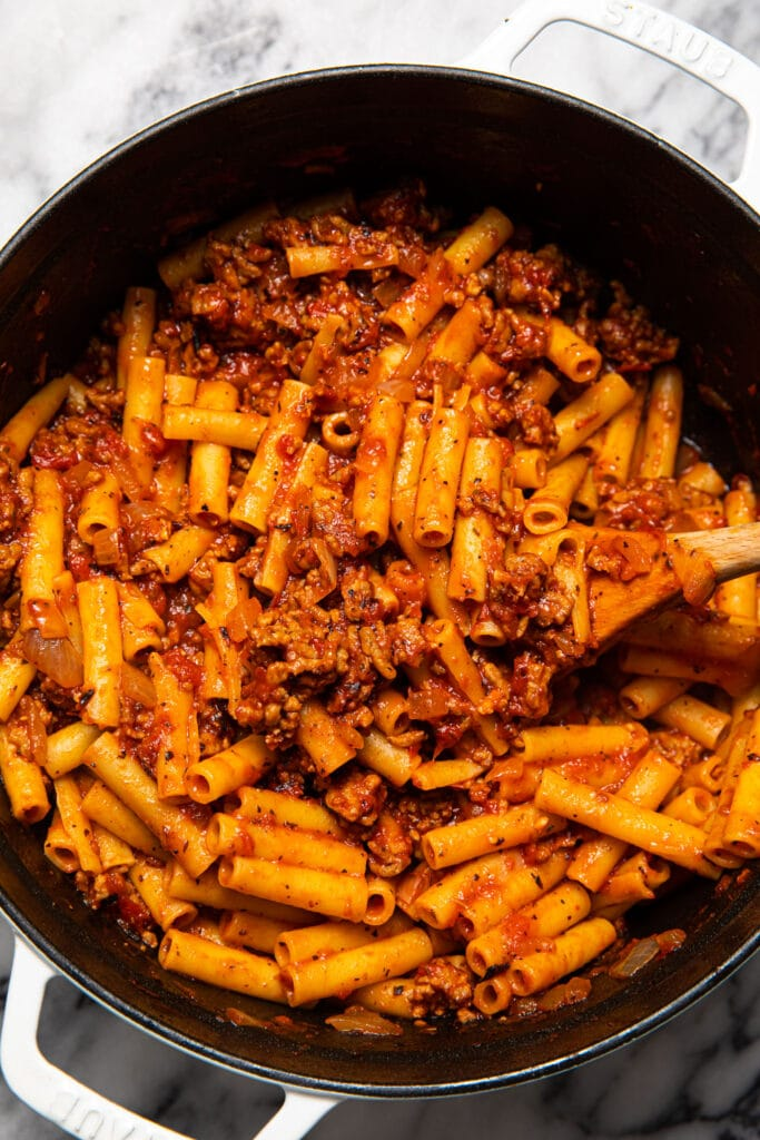 ziti and meat sauce in large white pot