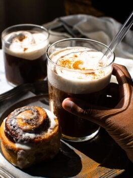 black hand holding maple cream cold brew in glass