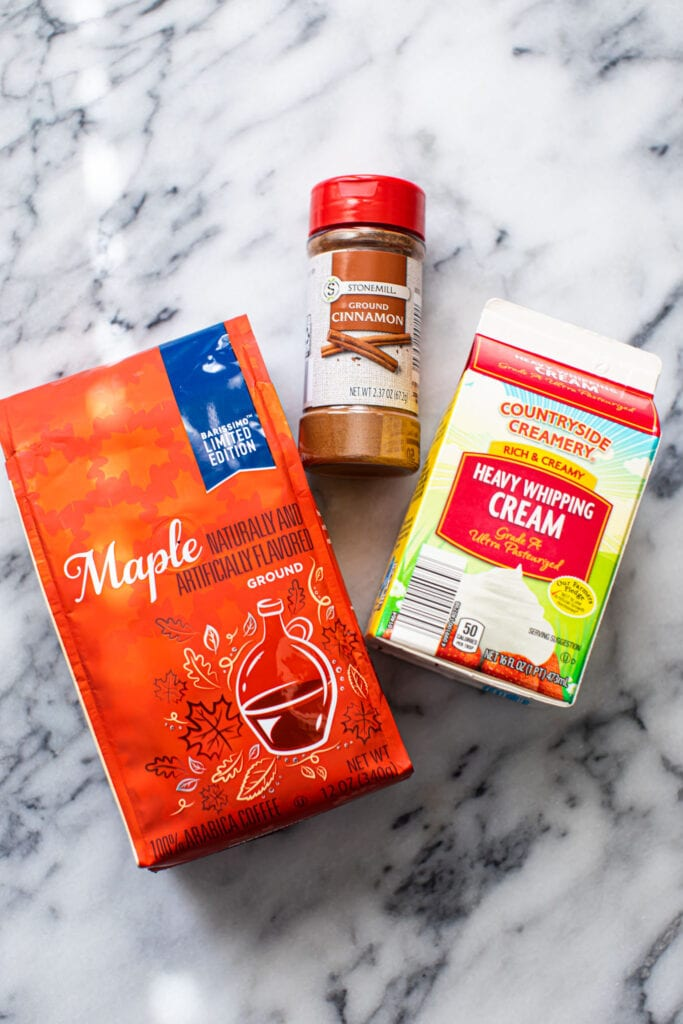 ingredients for maple cream cold brew on marble surface