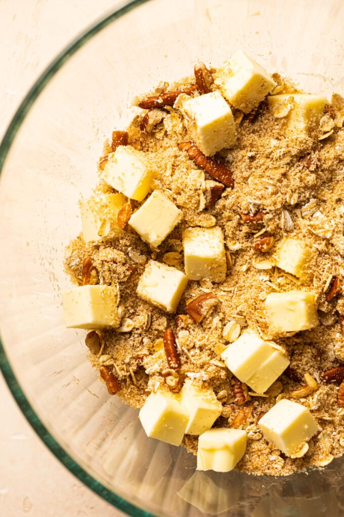 oats, pecans, and cubed butter in large glass bowl