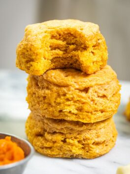 three sweet potato biscuits stacked on top of each other