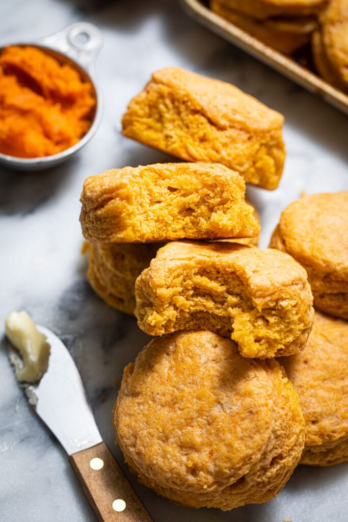sweet potato biscuits leaning on each other on marbled surface