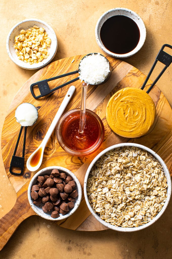 ingredients for peanut butter cup granola bars on beige surface