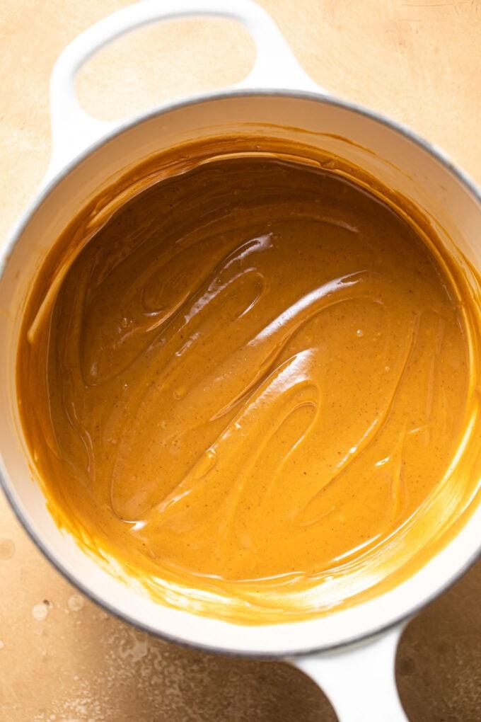 peanut butter sauce in small white saucepan
