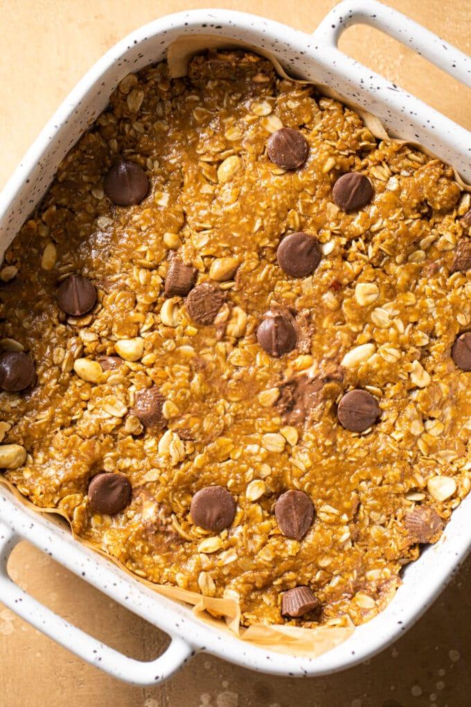 peanut butter granola pressed into small white baking dish