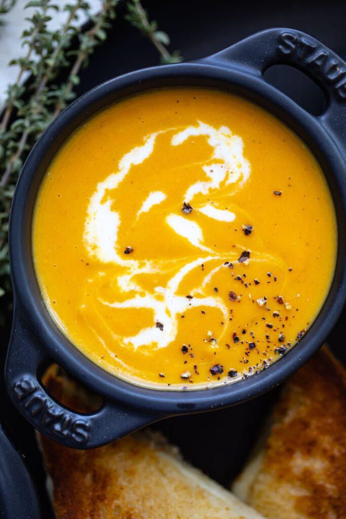 roasted butternut squash soup in mini black ramekin