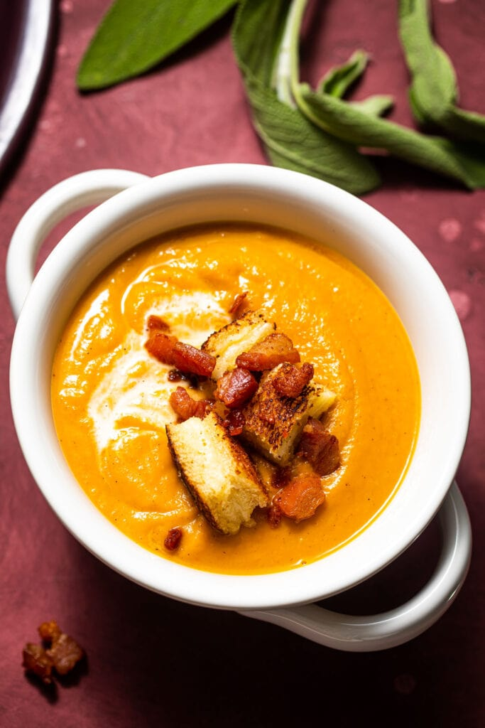sweet potato soup in white bowl with handles