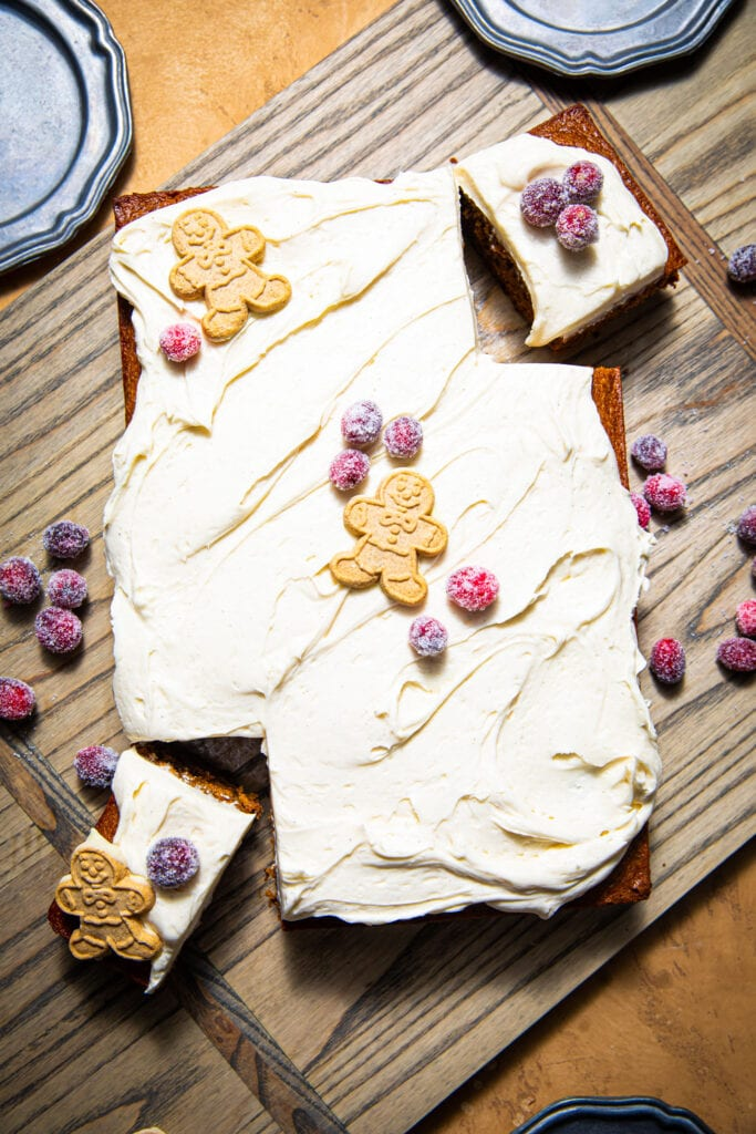 frosted gingerbread sheet cake on wood board