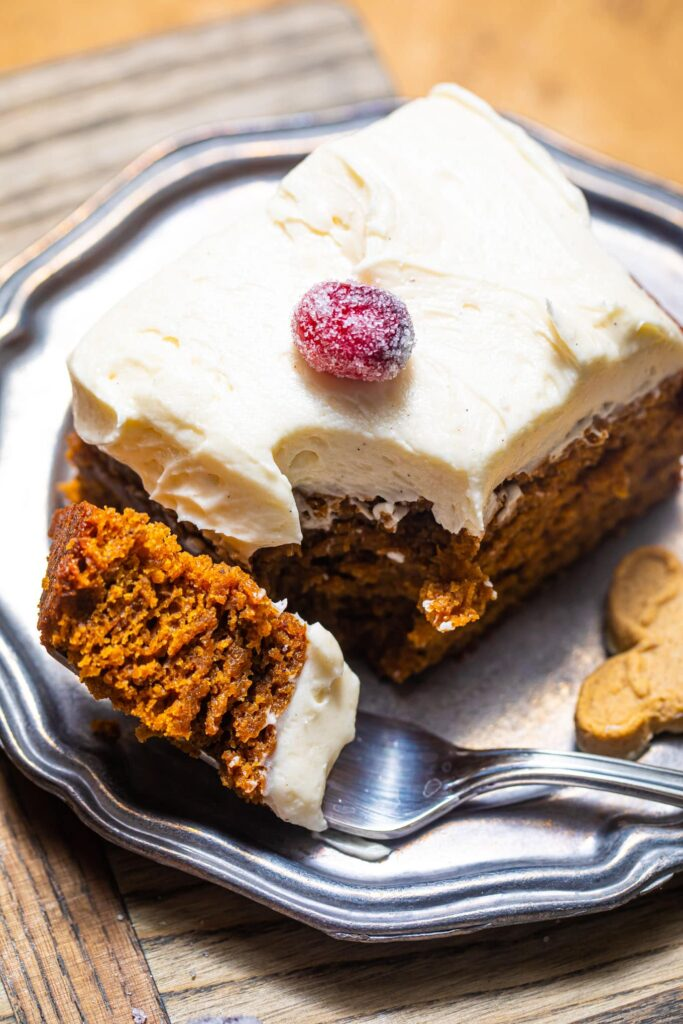 slice of gingerbread sheet cake on silver plate with fork