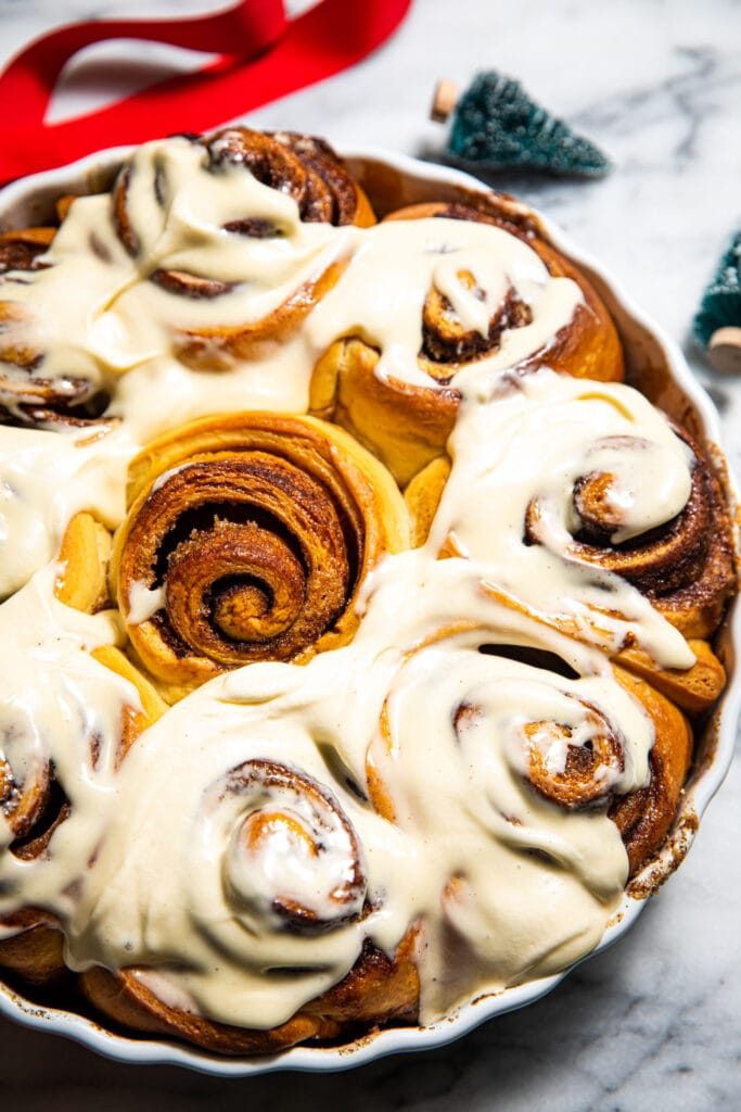 brown butter eggnog cinnamon rolls on marble surface