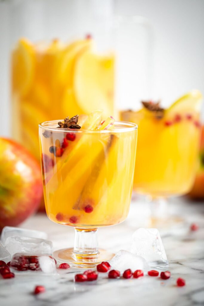 apple sangria in glass on marble surface