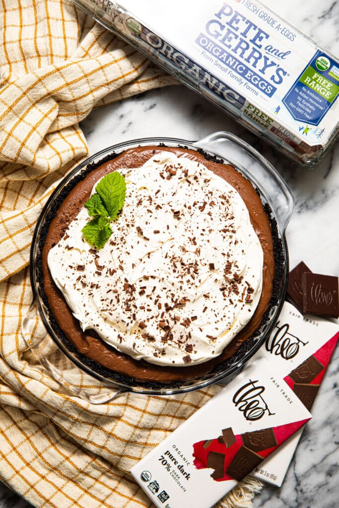 mocha chocolate cream pie with Theo chocolate bars and Pete and gerry's egg carton on the side