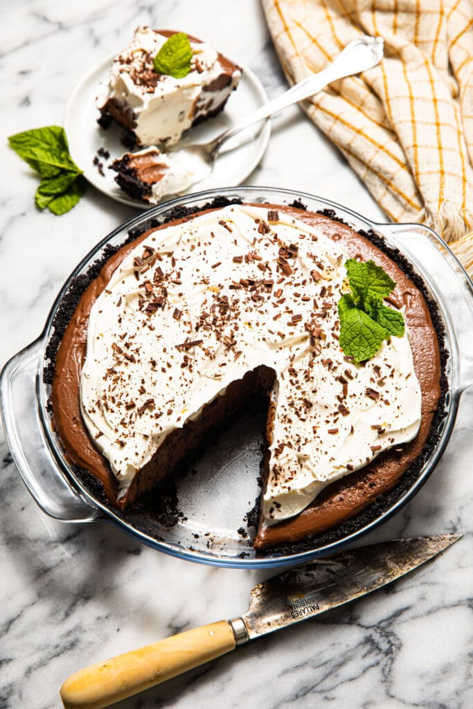 mocha chocolate cream pie with knife on marble surface