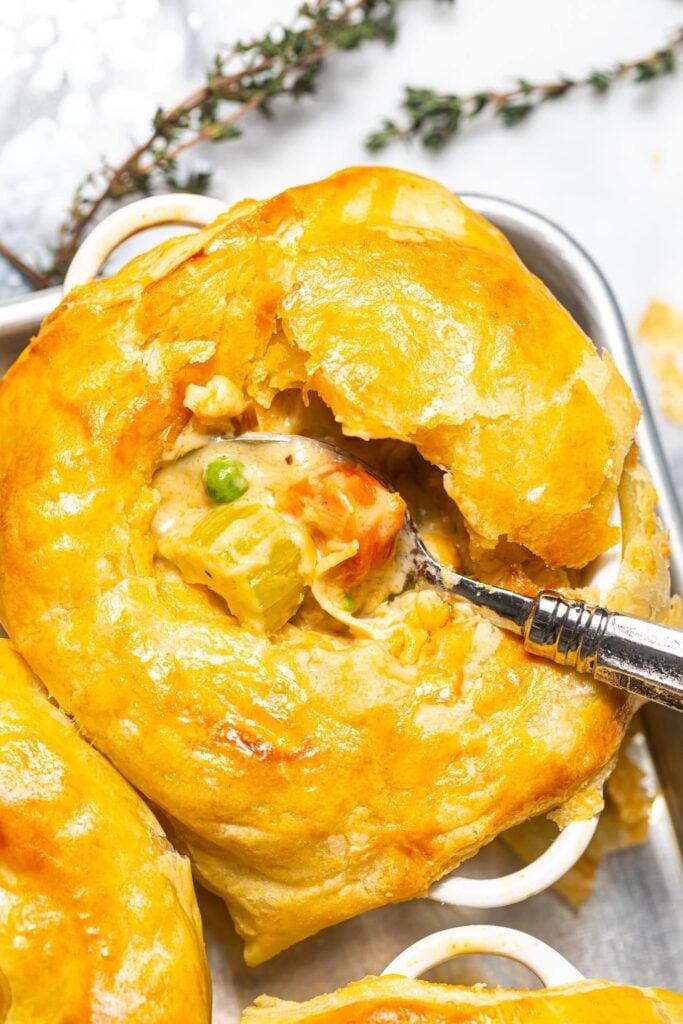 puff pastry chicken pot pie in small white ramekin
