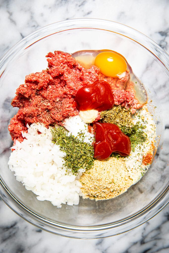 meatloaf ingredients combined in glass bowl