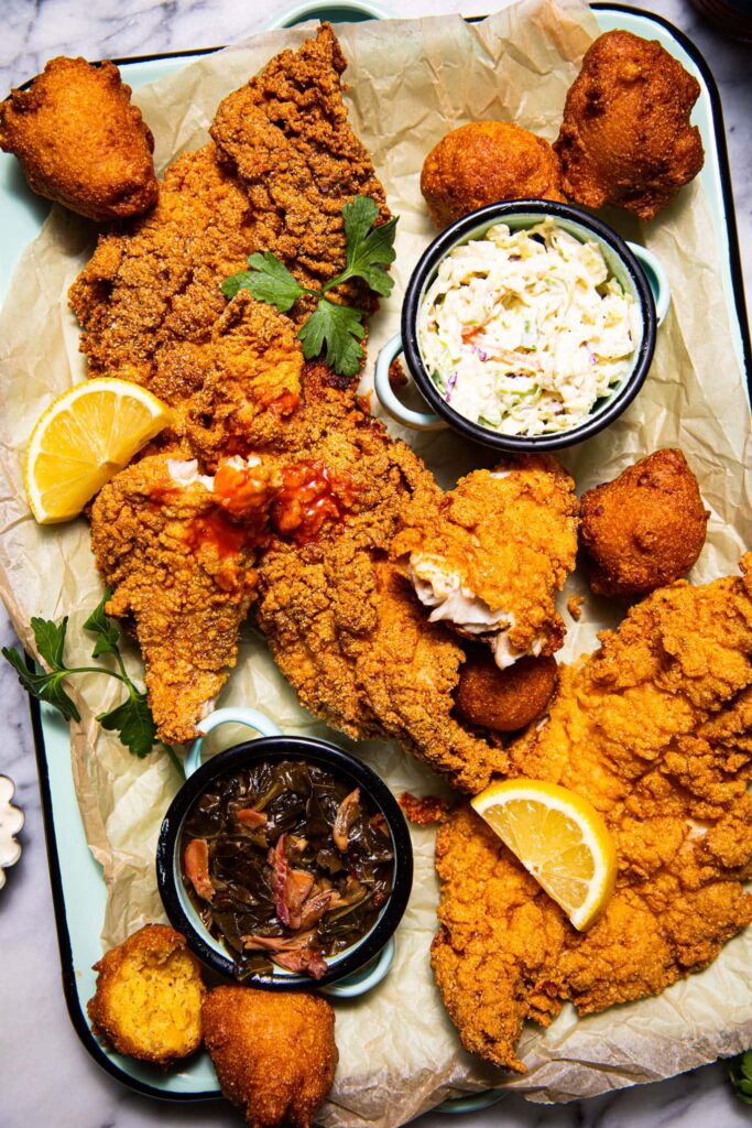 fried catfish with hush puppies on blue platter