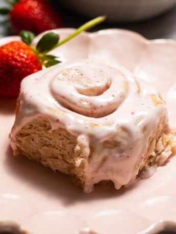 strawberry sweet roll on pink scalloped plate