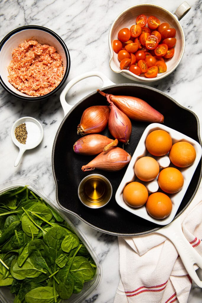 ingredients to make kitchen sink frittata on marble surface