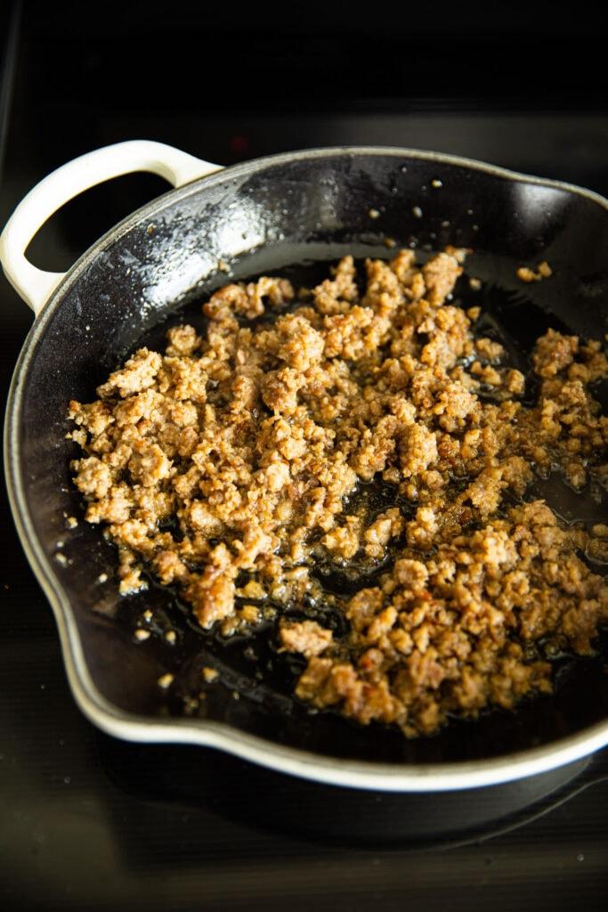 ground sausage in white skillet