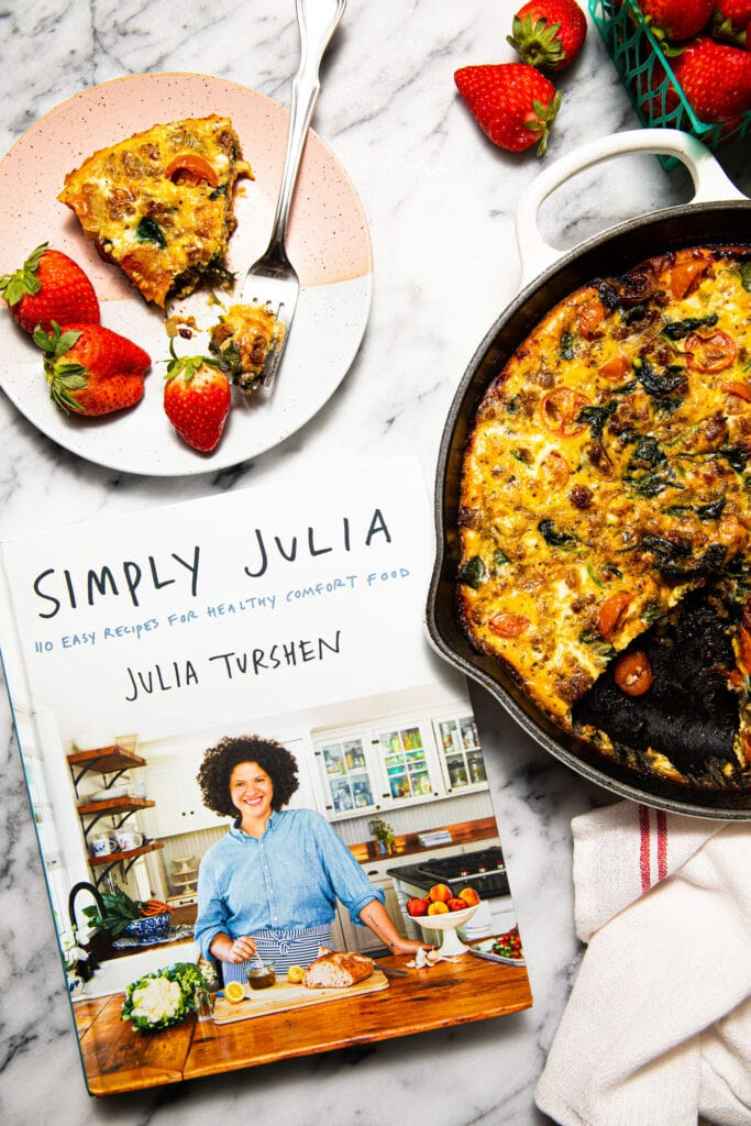 kitchen sink frittata in skillet with Simply Julia cookbook