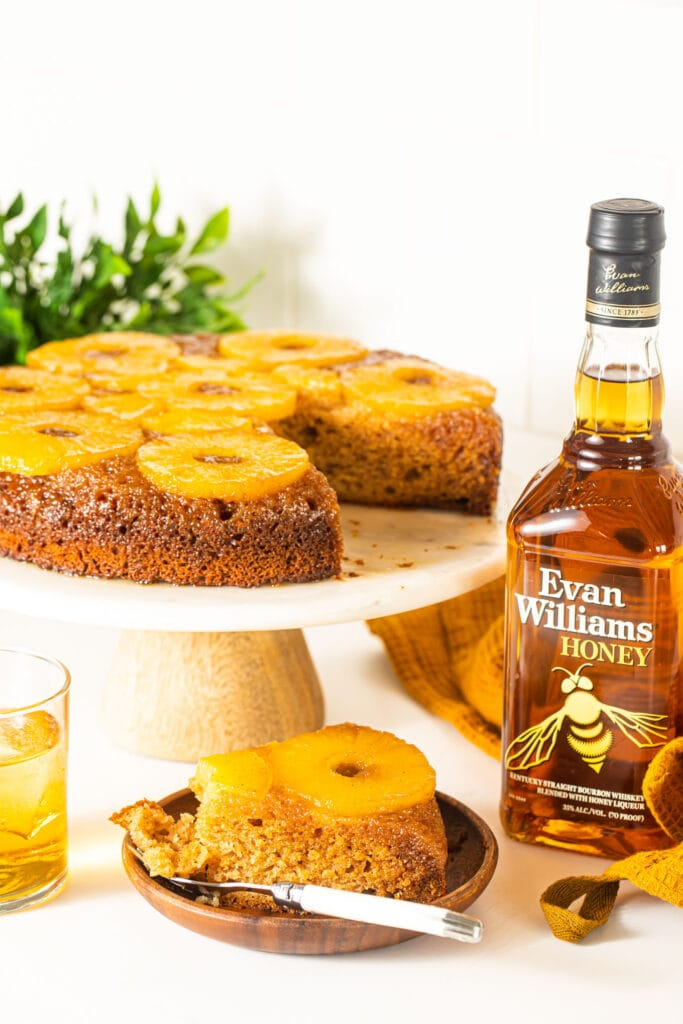 bourbon pineapple upside down cake with bottle of bourbon on the side