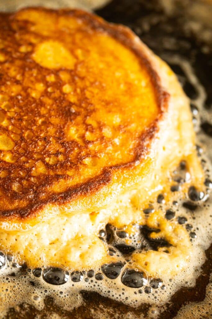 sweet potato pancake cooking on skillet