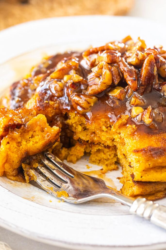 sweet potato pancakes on white plate with silver fork