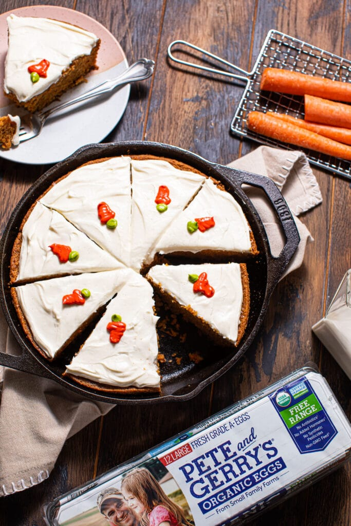 skillet carrot cake on wood surface with carton of Pete and gerry's eggs