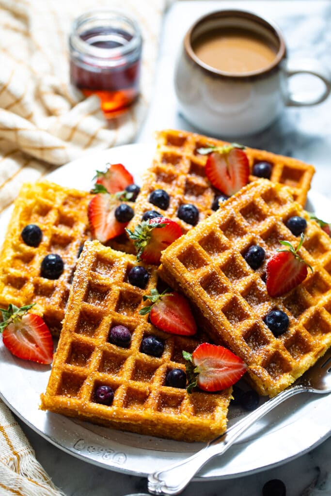 buttermilk waffles with fruit on white plate