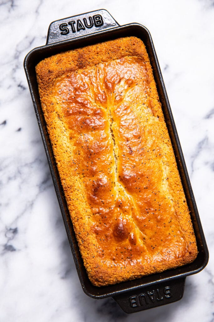 load of lemon poppy seed bread in black loaf pan