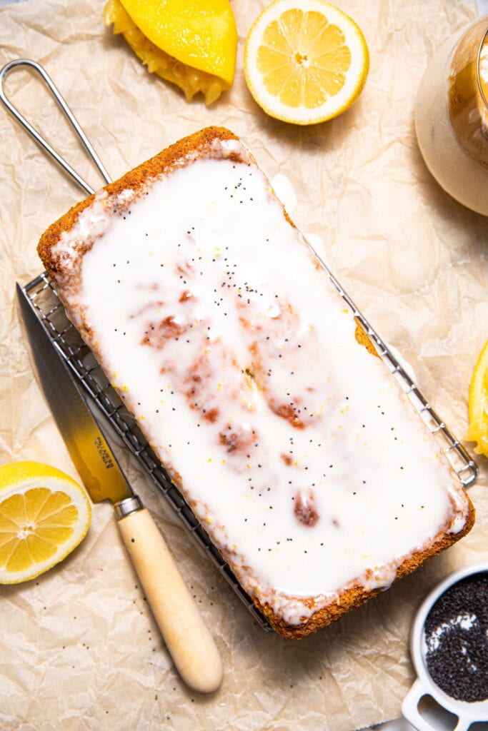 glazed lemon poppy seed bread on wire rack with knife on the side