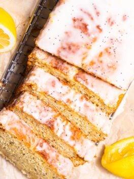 sliced and glazed lemon poppy seed loaf on wire rack