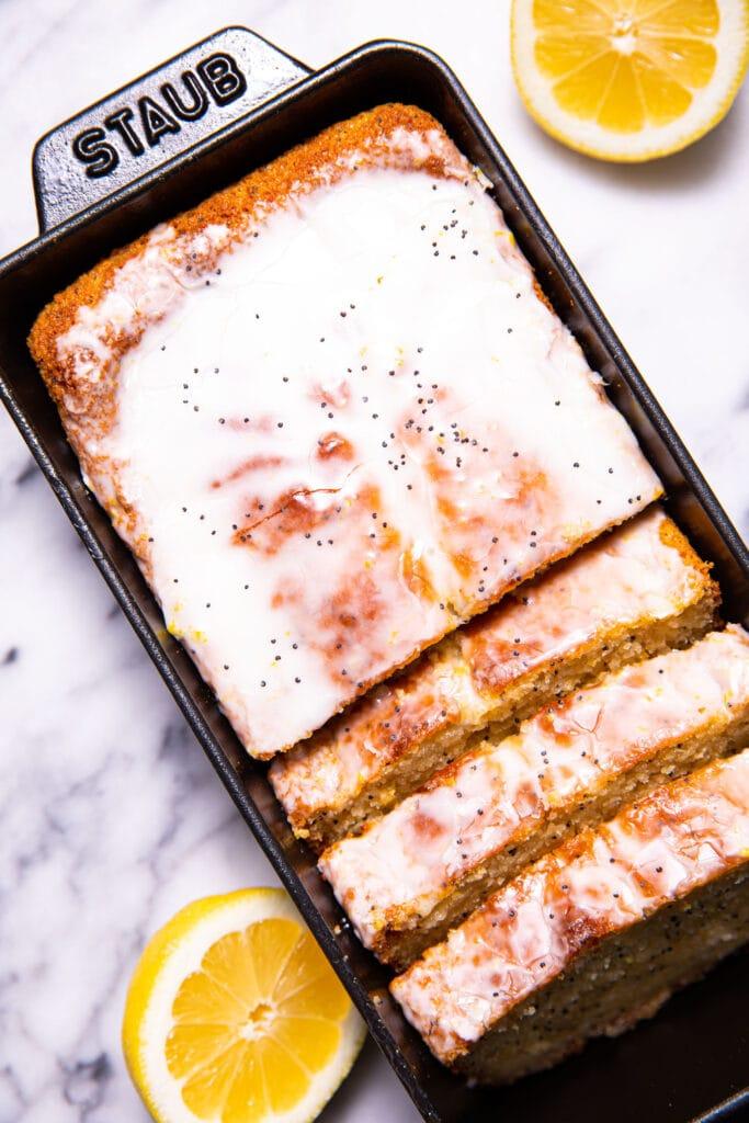 sliced lemon poppy seed bread in black loaf pan