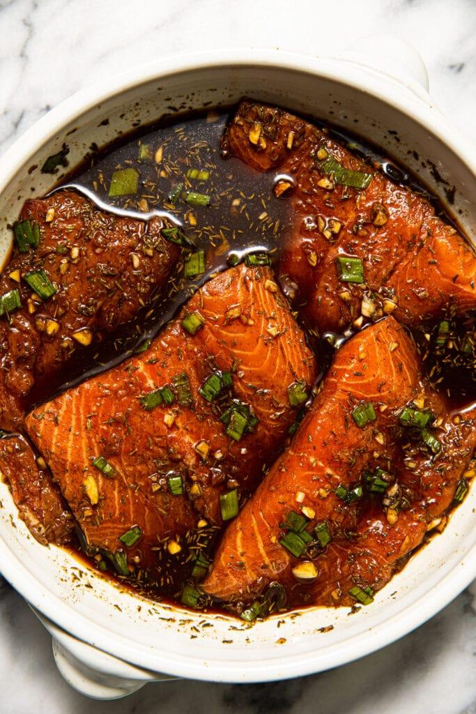 marinated jerk salmon in large round dish