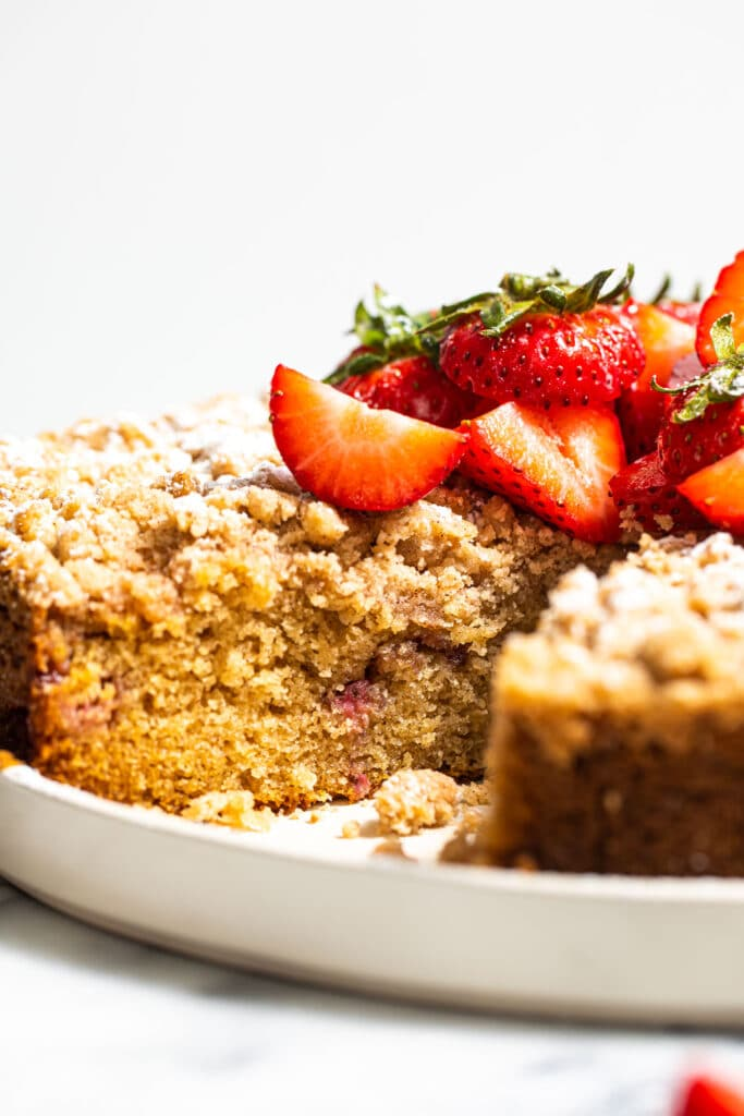 side strawberry crumb cake on white plate