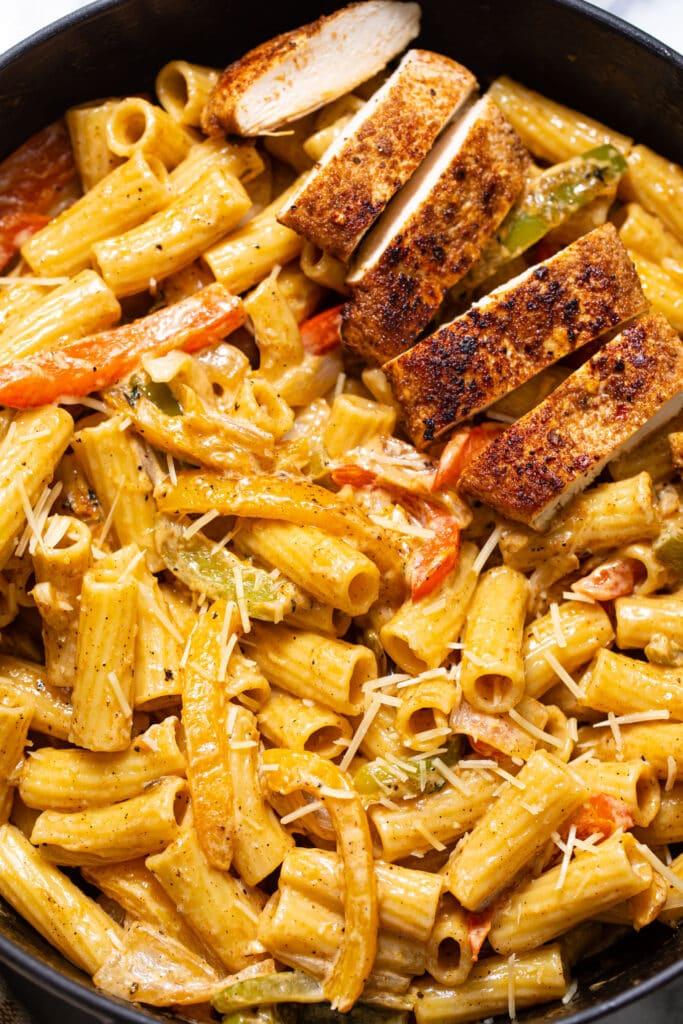 creamy Rasta Pasta with chicken in skillet