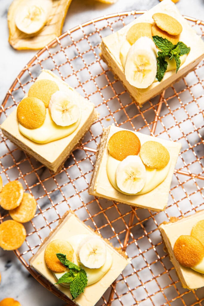 banana pudding cheesecake bars on copper wire rack