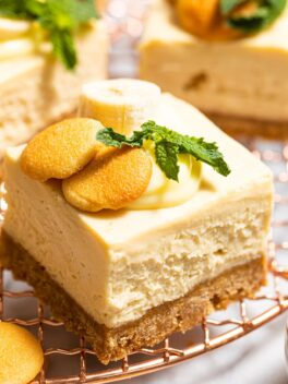 banana pudding cheesecake bar on copper wire rack