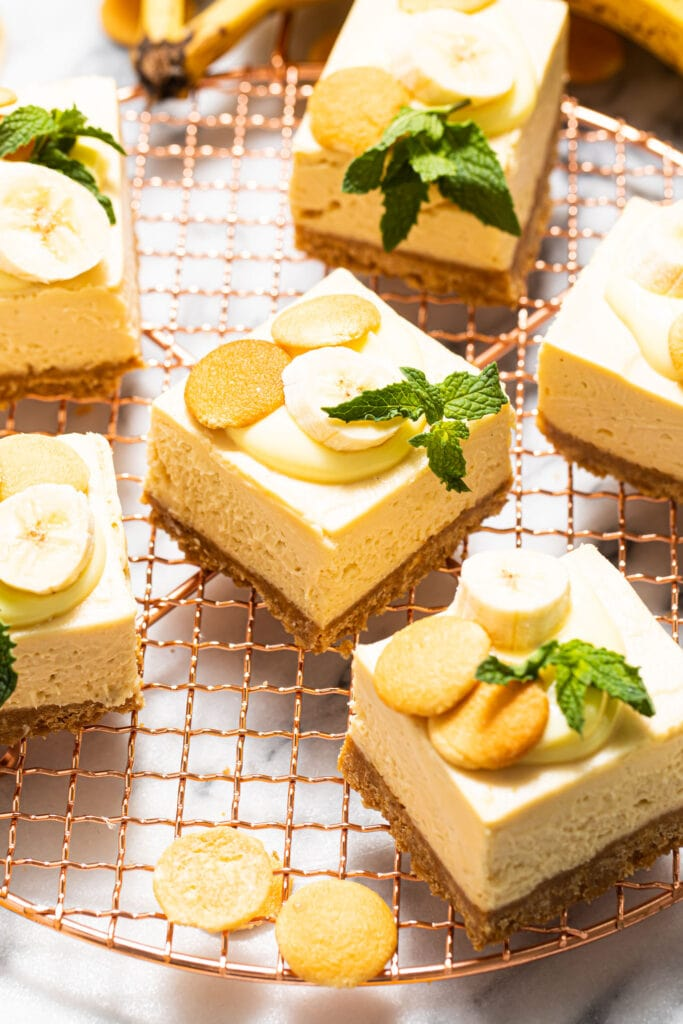 banana pudding cheesecake bars on top of copper wire rack