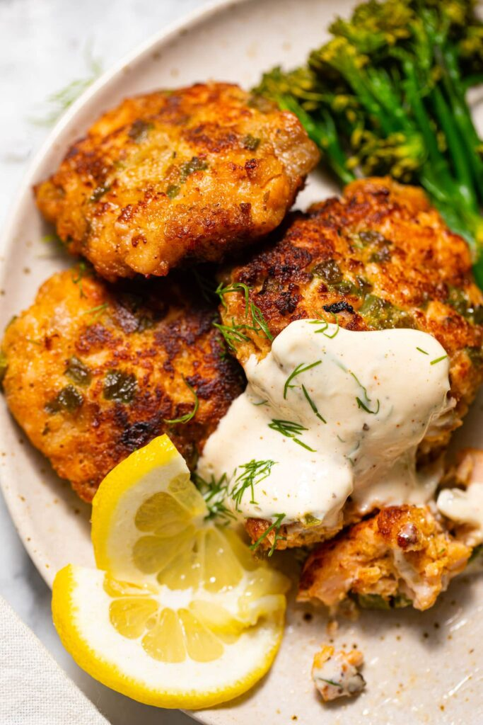 salmon cakes with aioli on speckled plate