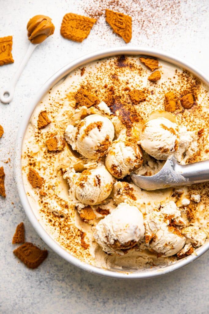 biscoff espresso ice cream in round cake pan with ice cream scoop